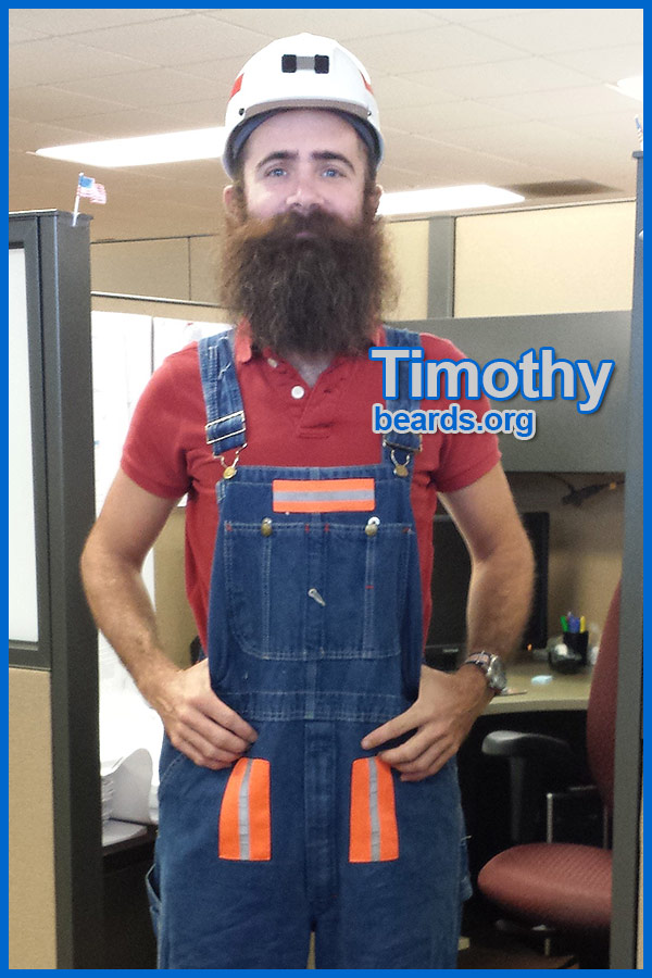 Timothy trying on gear for going down into a coal mine for his internship job.